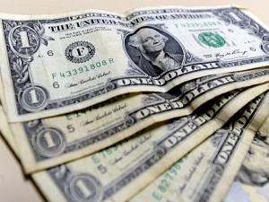 Segundo especialista, dólar deve variar menos em 2014